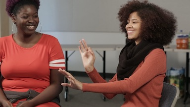 Two female Gallaudet students using Black ASL